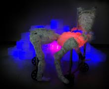 Sculpture in an animal shape made from plastic discards and glowing lights