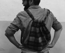photograph of Faux Frau Rudi modeling his completed back pack