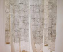 a sculpture by Eileen Parent titled Hanging Forest made of several etchings
