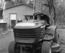 black and white photograph of a farm-equipment type lawn mover