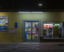 photograph of a liquor store at night
