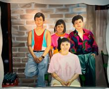 a painting of a family portrait with 4 people titled Los Chiquillos by Jiovanny Soto