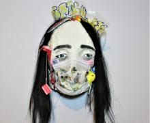 white mask with black hair and colorful tags