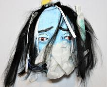 white and light blue face mask with black hair