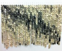 large paper hanging paper sculpture by Eileen Parent titled Murmuration