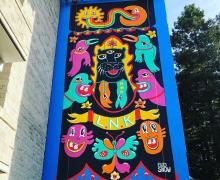 large colorful mural with crazy cartoony faces throughout