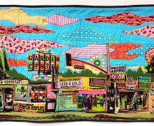 multi-colored quilt depicting a city scape