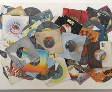 a watercolor painting of a messed up pile of 45 records