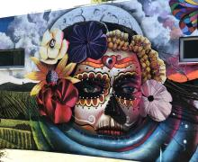 colorful mural with Day of the Dead skeleton imagery